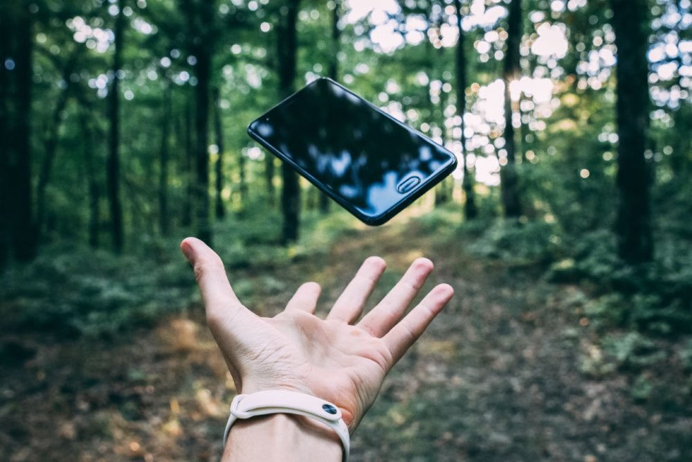 person throwing black smartphone