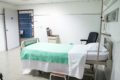 gray gatch bed in hospital